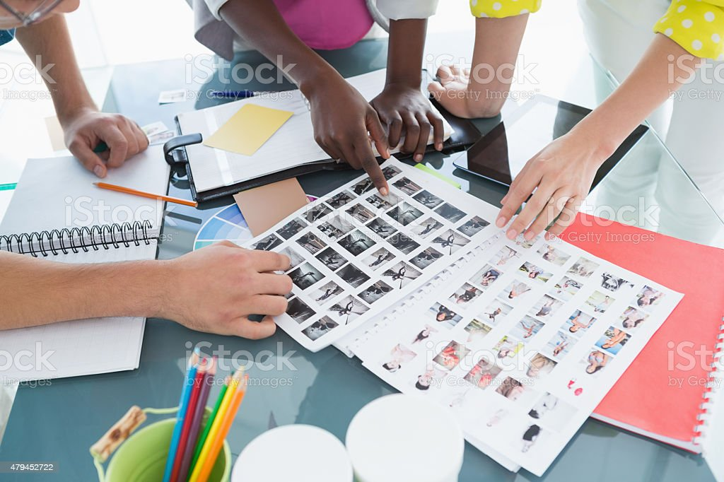 Young creative team having a meeting stock photo