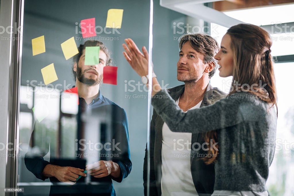 Young creative team mind mapping on post it notes stock photo