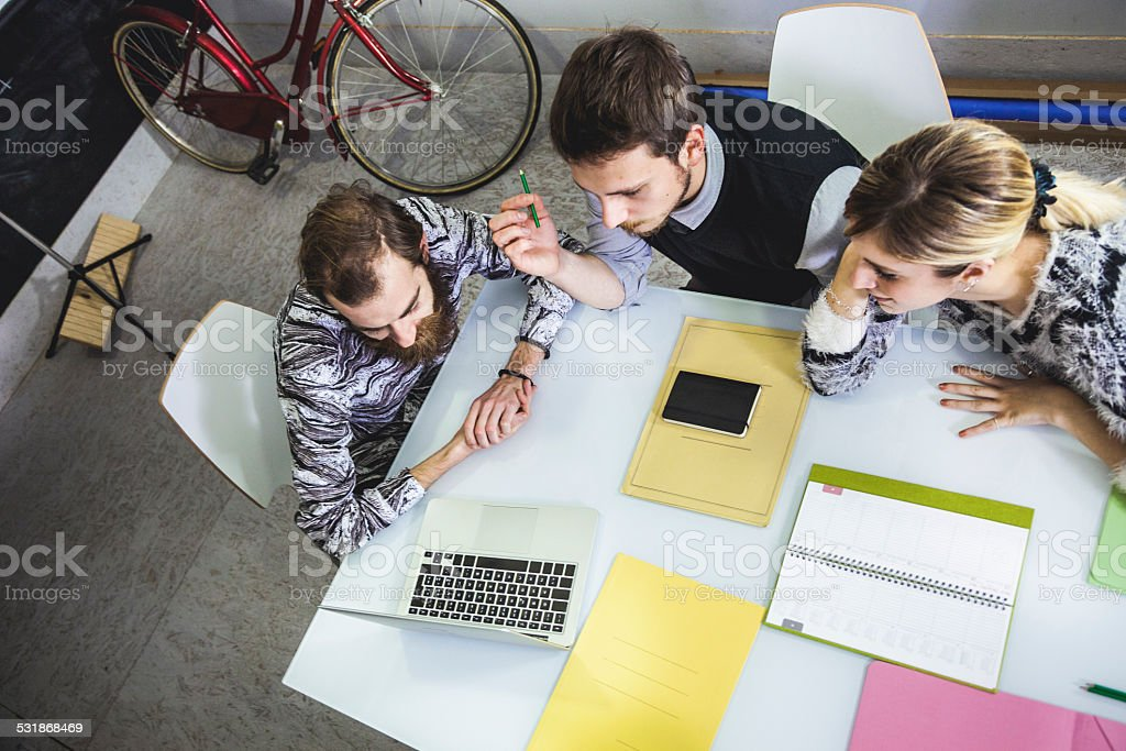Young creative team working on a project stock photo