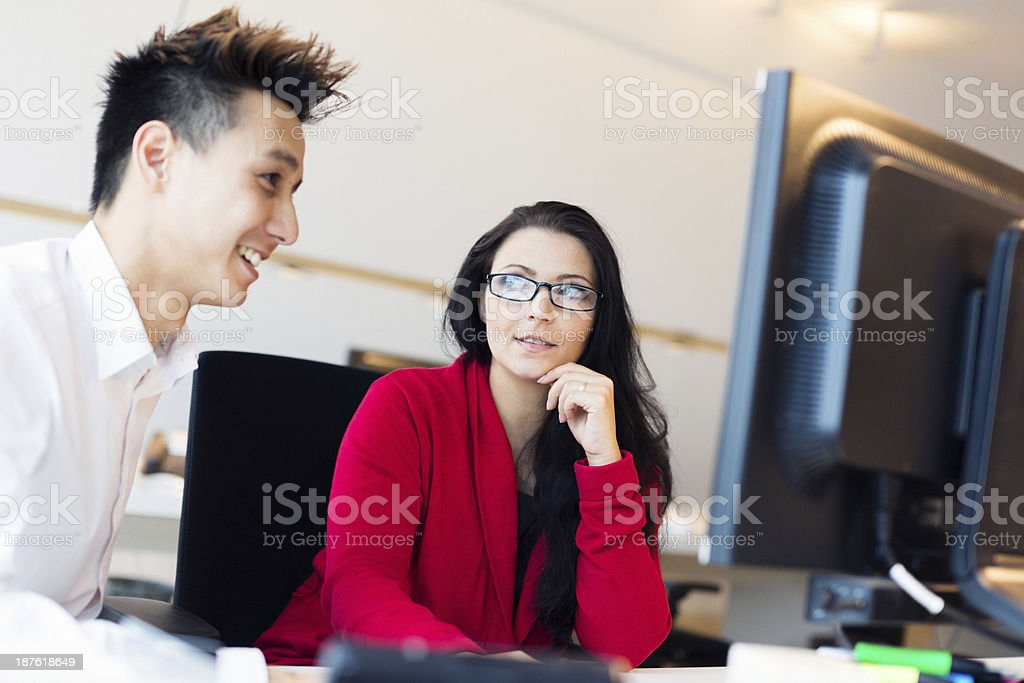 young creative team working on their computer royalty-free stock photo