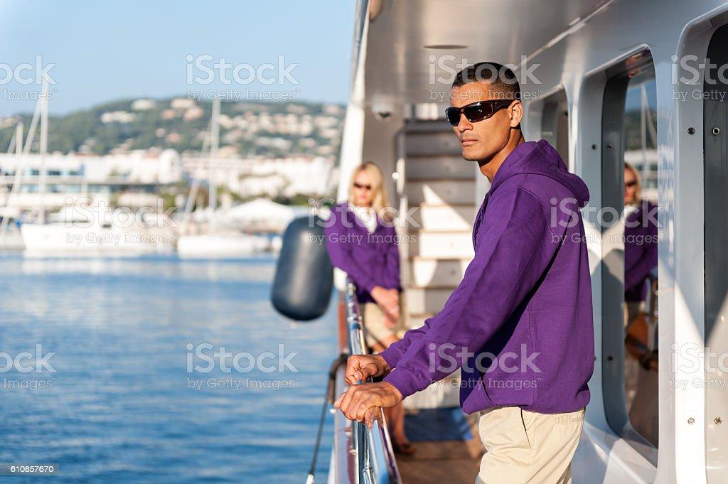 Young crew members on luxury yacht stock photo