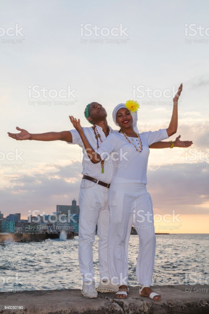 Young Cuban couple at sunset, Malecon, Havana, Cuba stock photo