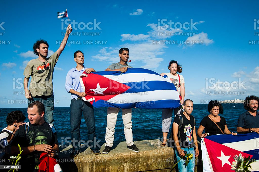 Young Cubans hold a Cuban flag stock photo