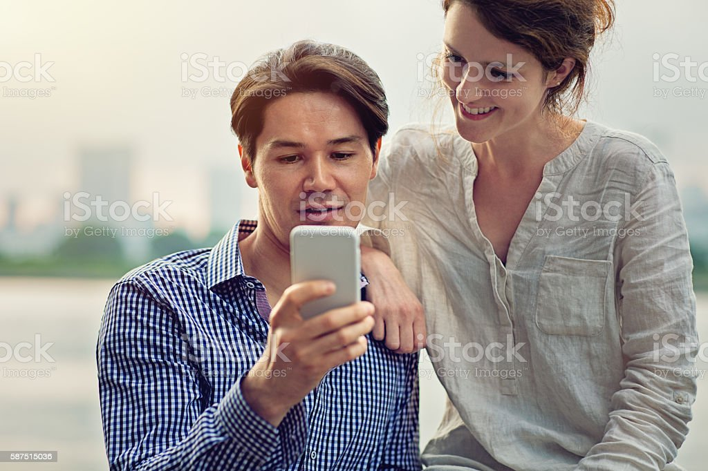 Young cuople is looking in mobile phone stock photo