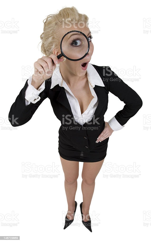 young curious woman holding detective magnifying glass enlarging her eye royalty-free stock photo