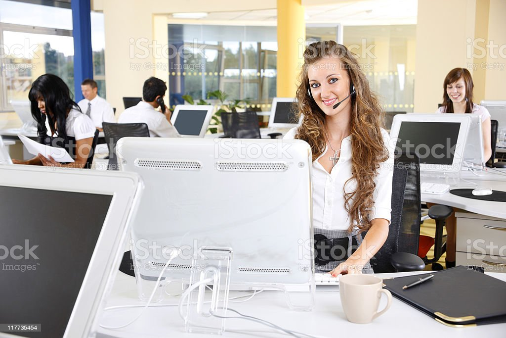 young customer service team working in modern open office royalty-free stock photo