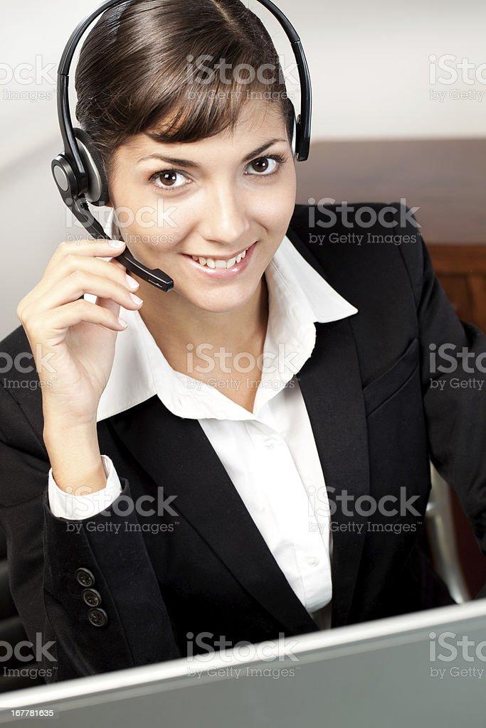Young customer servicer representative talking royalty-free stock photo