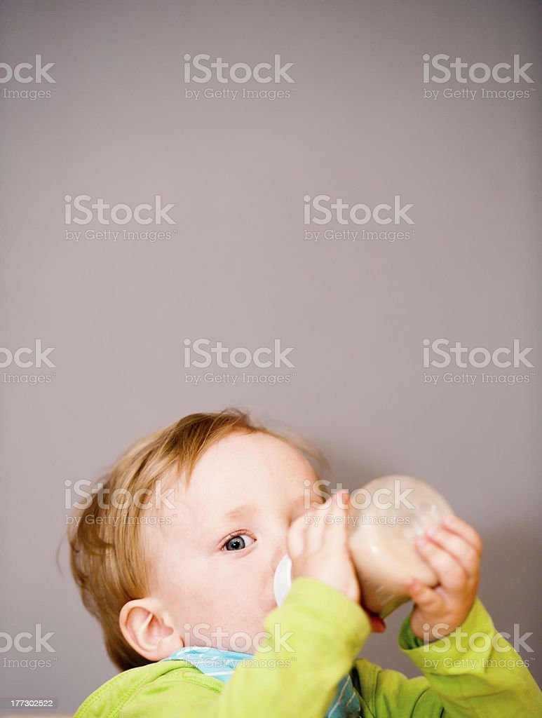 Young cute boy is drinking stock photo