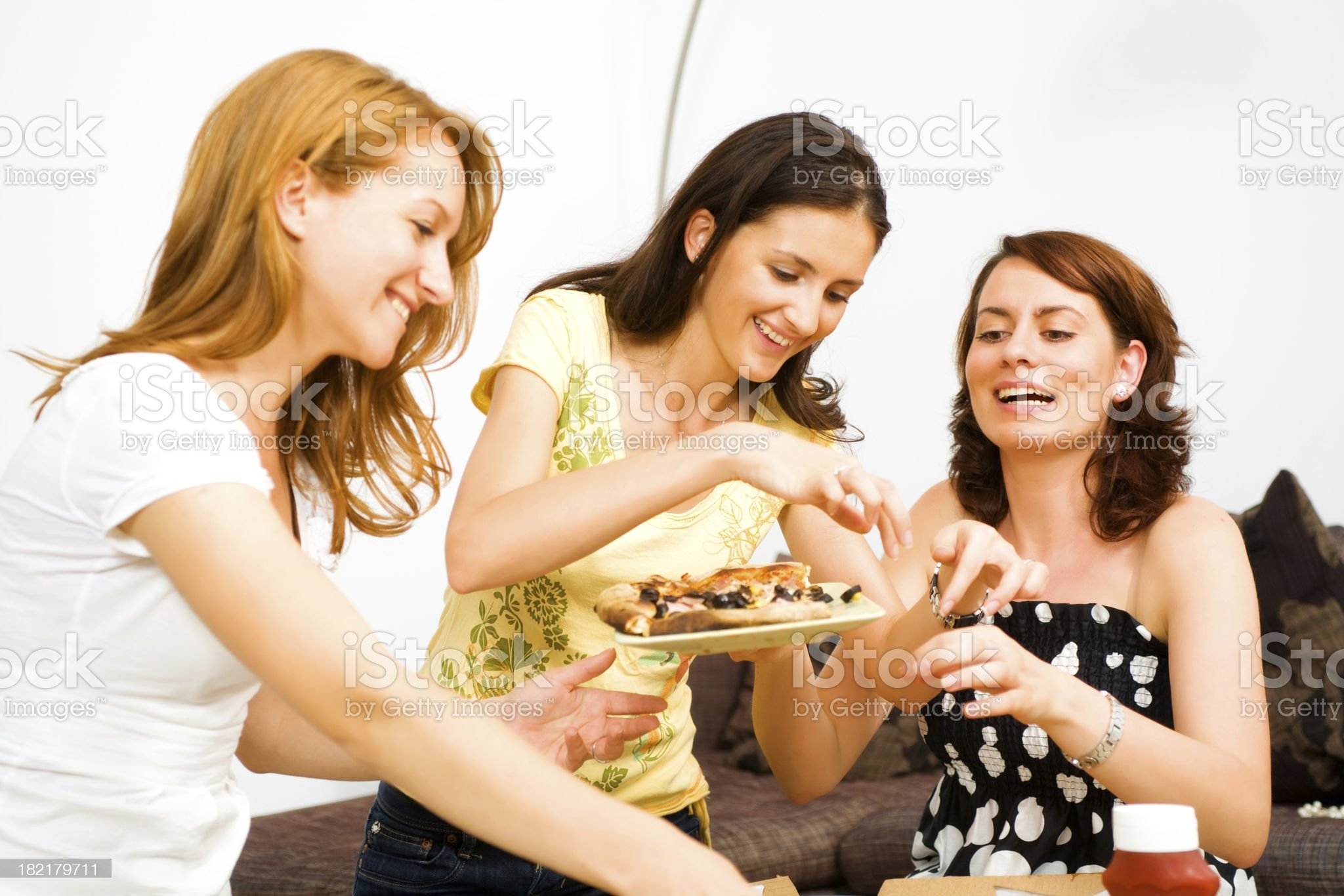Young cute females enjoying pizza royalty-free stock photo