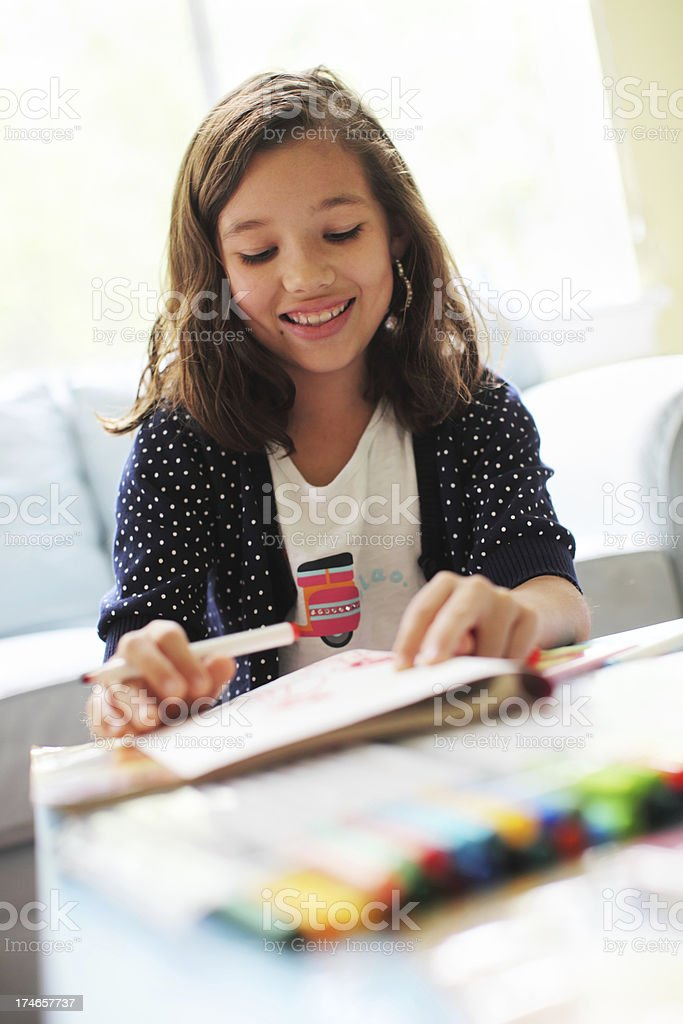 Young cute girl doing schoolwork royalty-free stock photo
