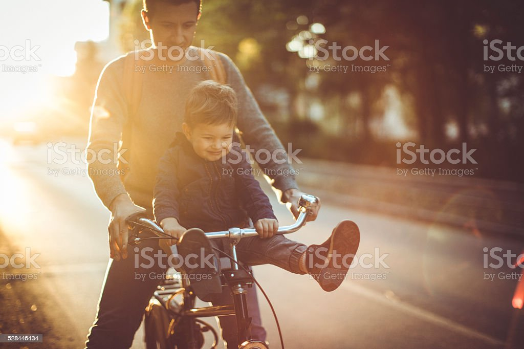 Young cyclist and his father stock photo