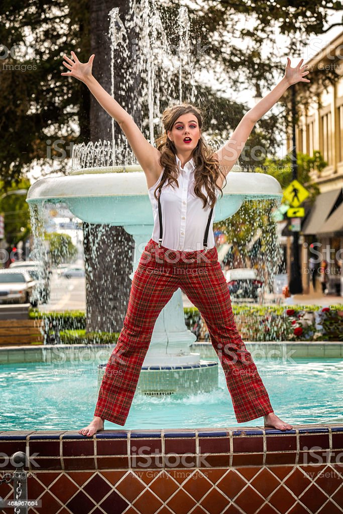 Young Dancer Dancing On a Fountain stock photo