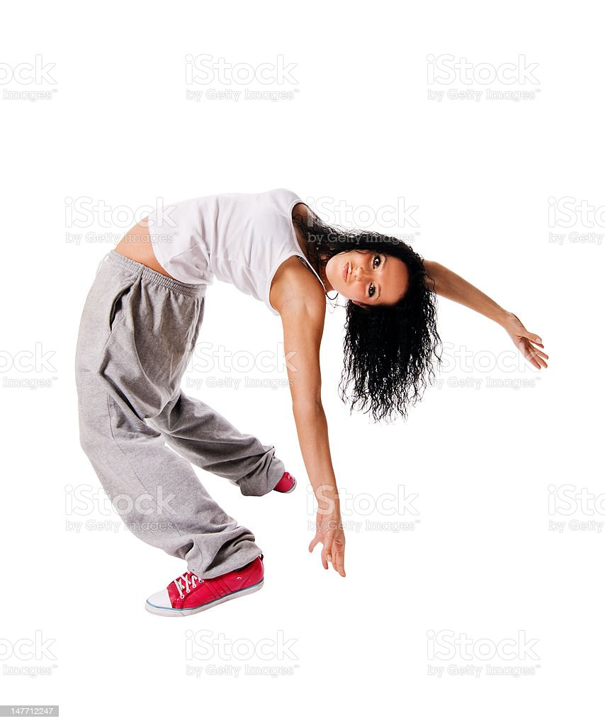 Young dancer making a move on white background royalty-free stock photo