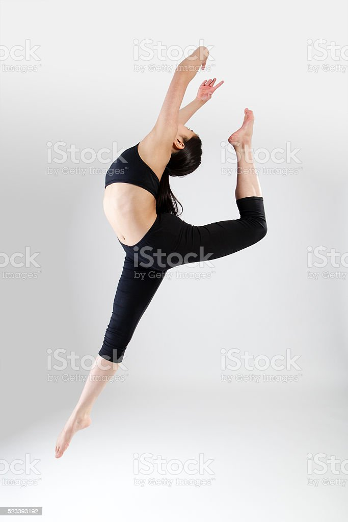 Young Dancer Performing a Ring Jump stock photo