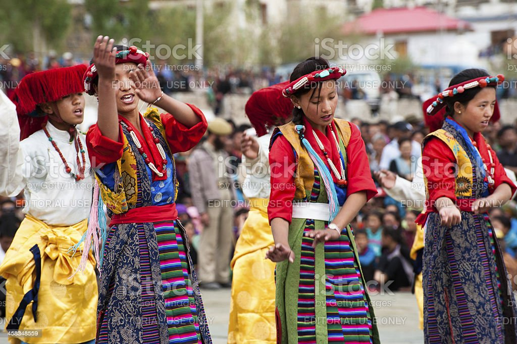 Young dancers in traditional Tibetan clothes performing folk dance royalty-free stock photo