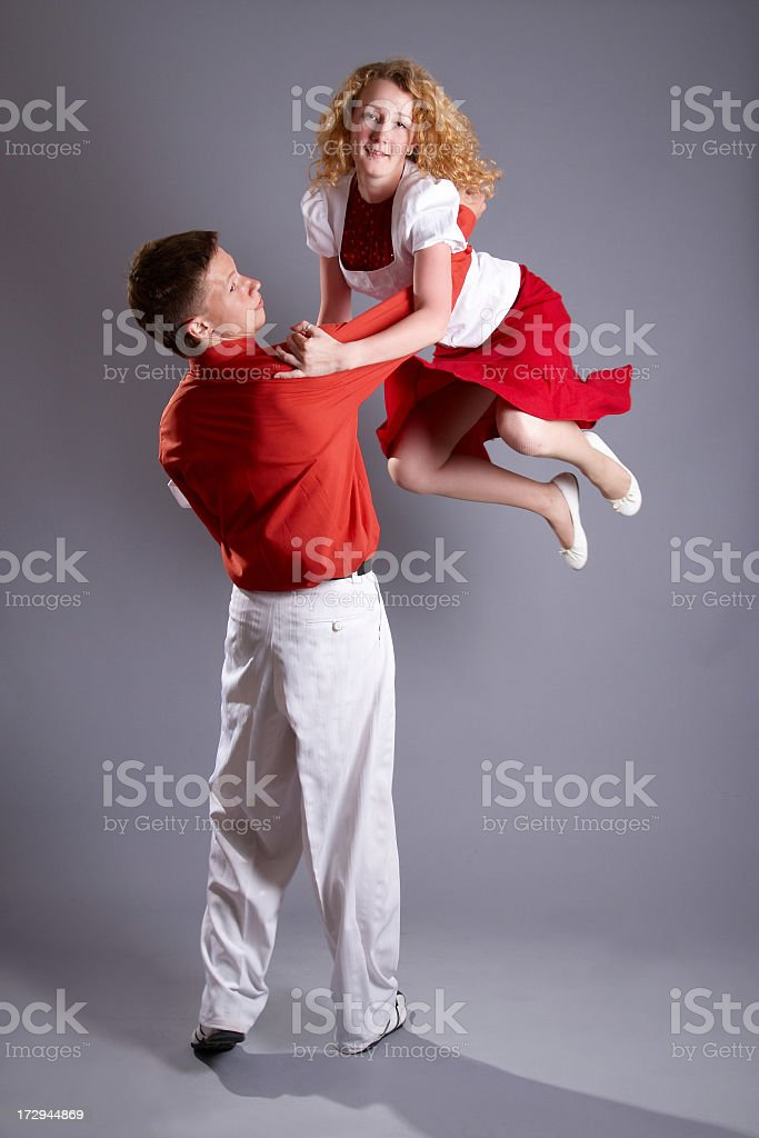 Young dancing couple in red outfits  stock photo