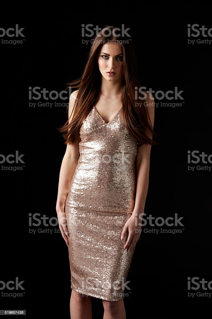 Young dark haired woman in evening dress, vertical stock photo