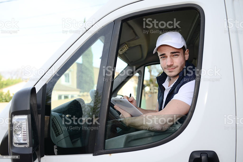 young delivery parcel service man with commercial van on background stock photo