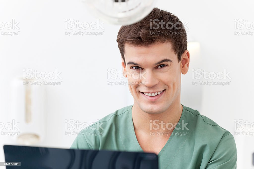 Young dental assistant smiling royalty-free stock photo
