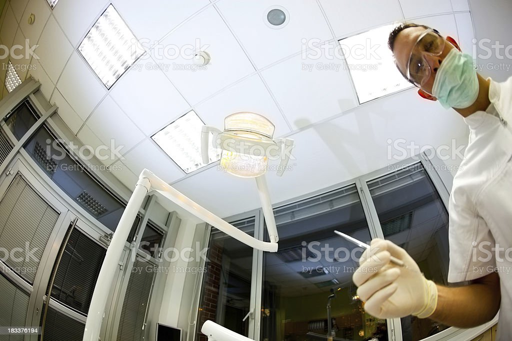 Young dentist in his ofiice starting to work royalty-free stock photo
