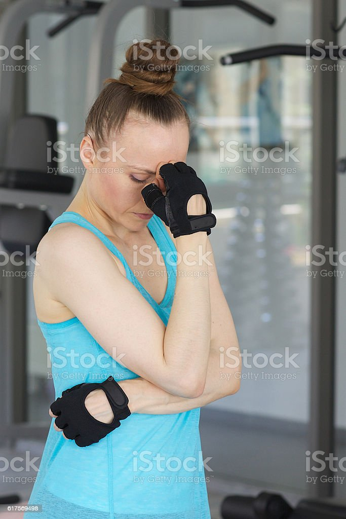 Young depressed woman  in a sport uniform stock photo