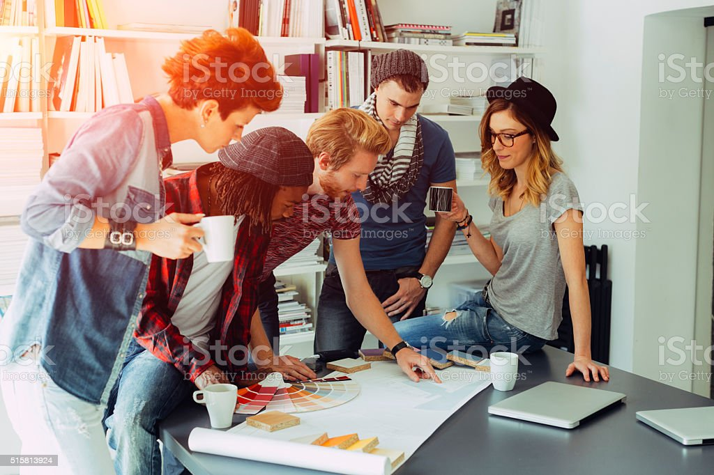 Young Designers Brainstorming In Their Office. stock photo