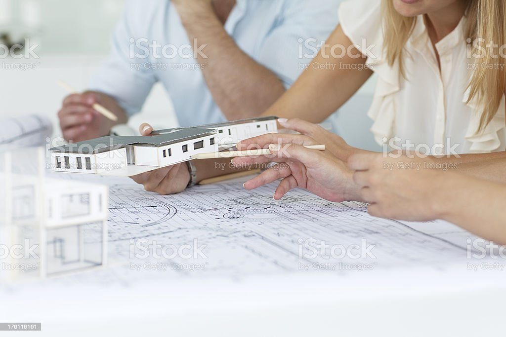 Young designers looking over plans royalty-free stock photo