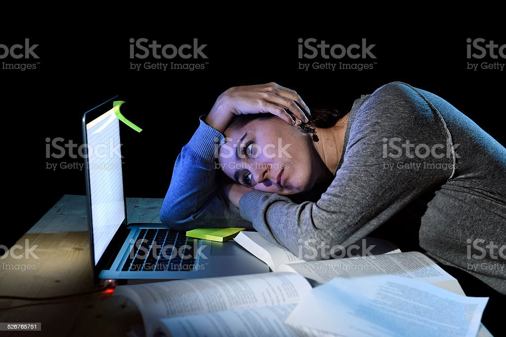 young desperate university student girl in stress for exam study stock photo
