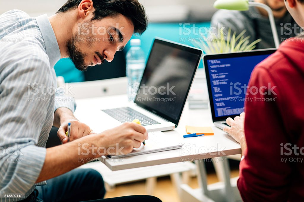 Young Developer Working In His Office. stock photo