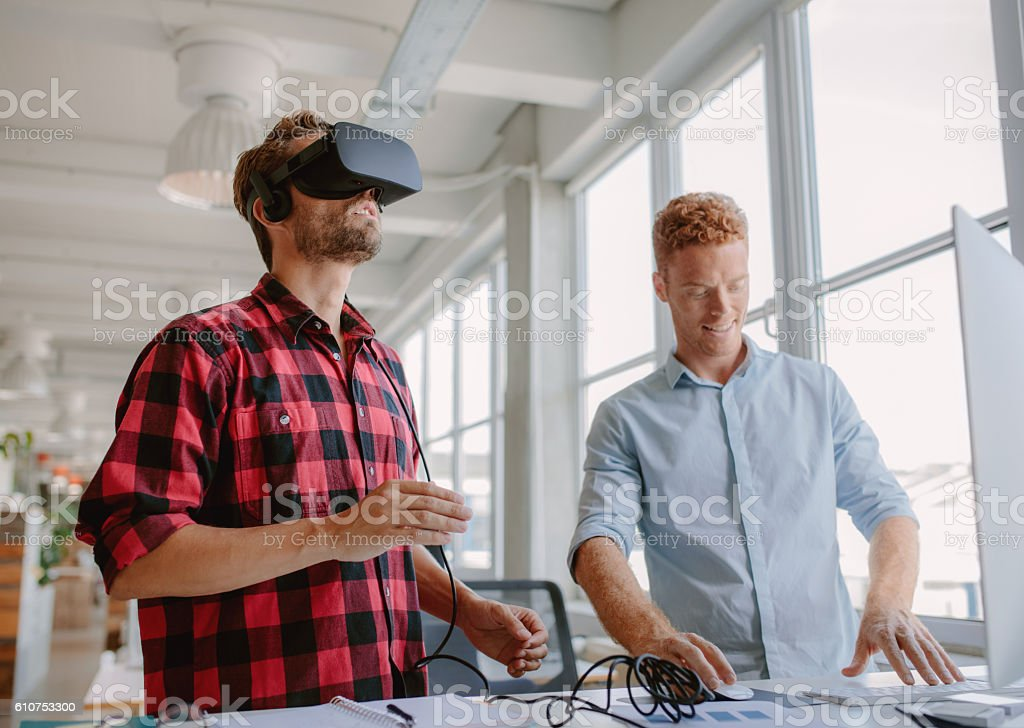 Young developers improving virtual reality glasses stock photo