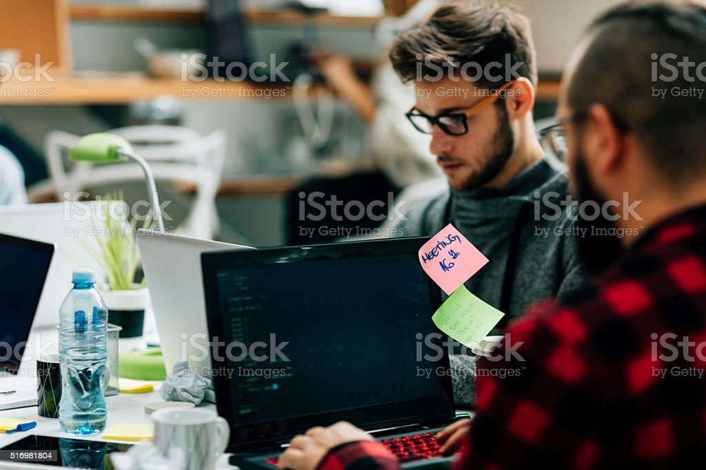 Young Developers Working In Their Office. stock photo