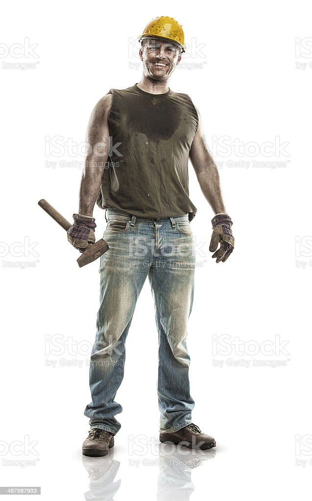 Young dirty Worker Man With Hard Hat helmet holding hammer stock photo