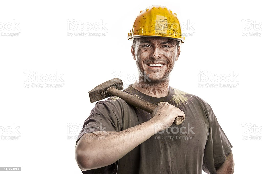 Young dirty Worker Man With Hard Hat helmet holding hammer royalty-free stock photo