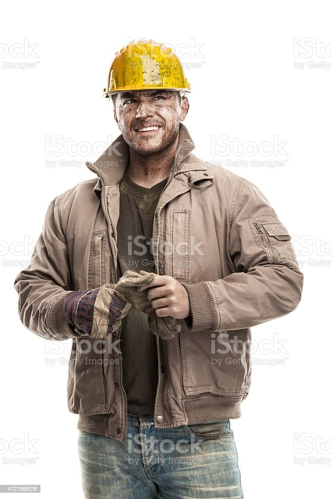 Young dirty Worker Man With Hard Hat helmet stock photo