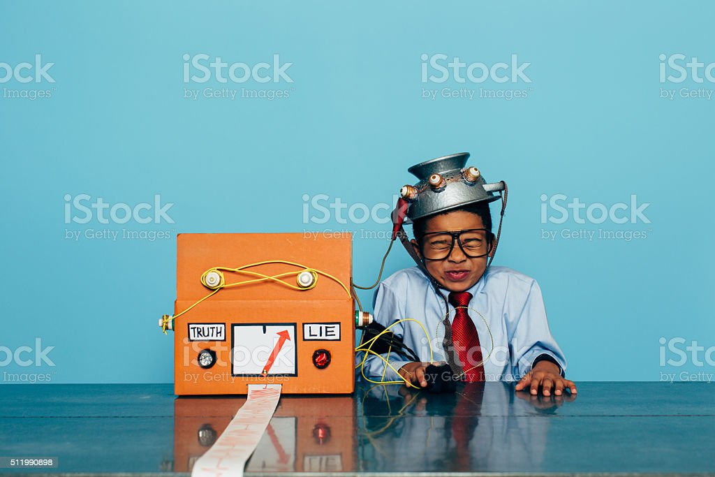 Young Dishonest Businessman with Lie Detector stock photo
