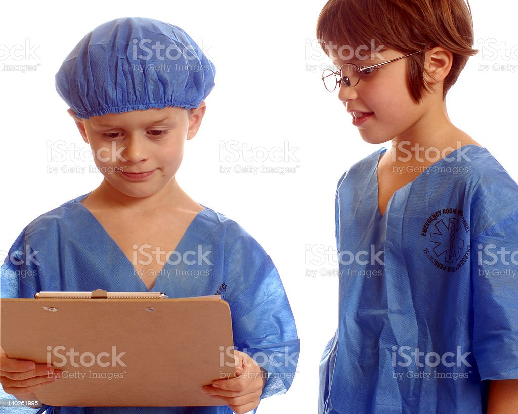 Young Docs Studying a Patient's Chart stock photo