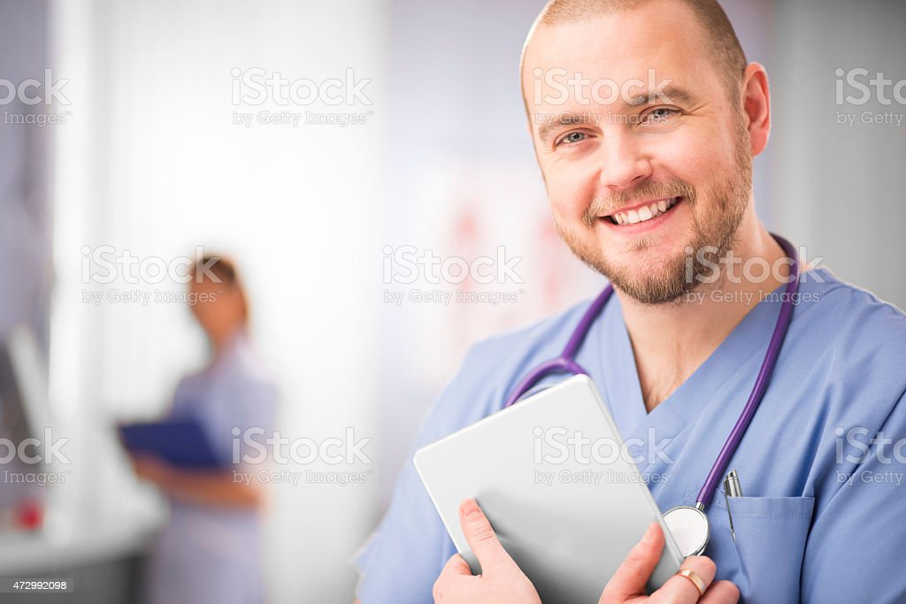 Young doctor and tablet. stock photo