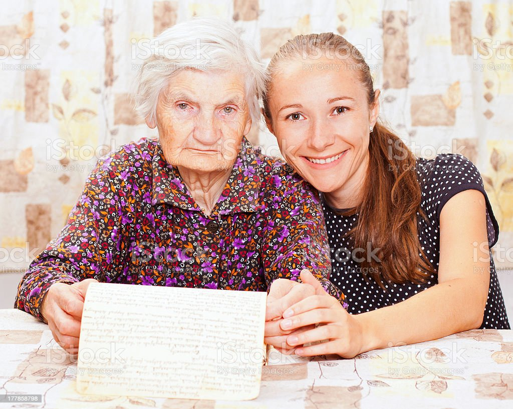 Young doctor holds the old  woman's hand royalty-free stock photo