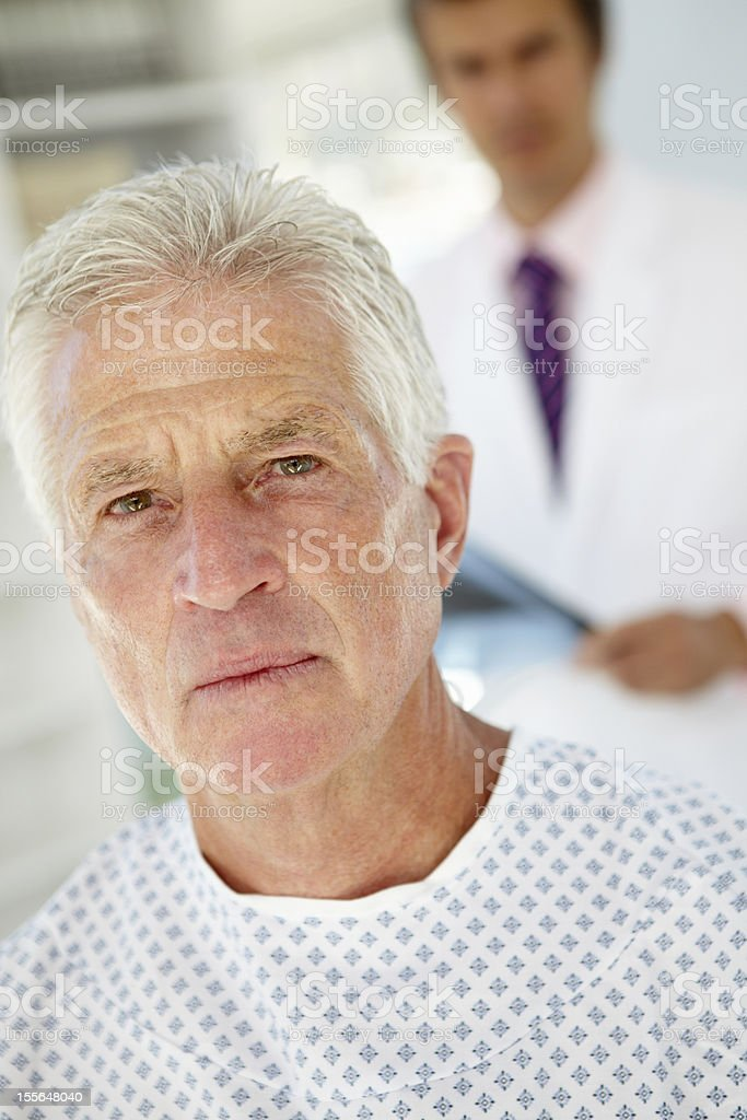 Young doctor meeting with senior patient stock photo