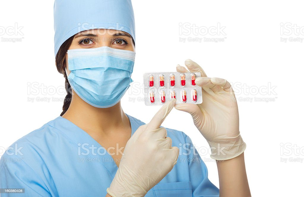 Young doctor showing red pills royalty-free stock photo