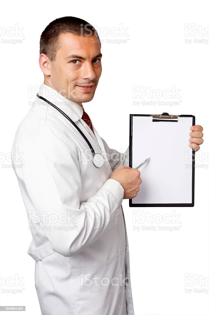 Young doctor showing something on blank page of notebook royalty-free stock photo