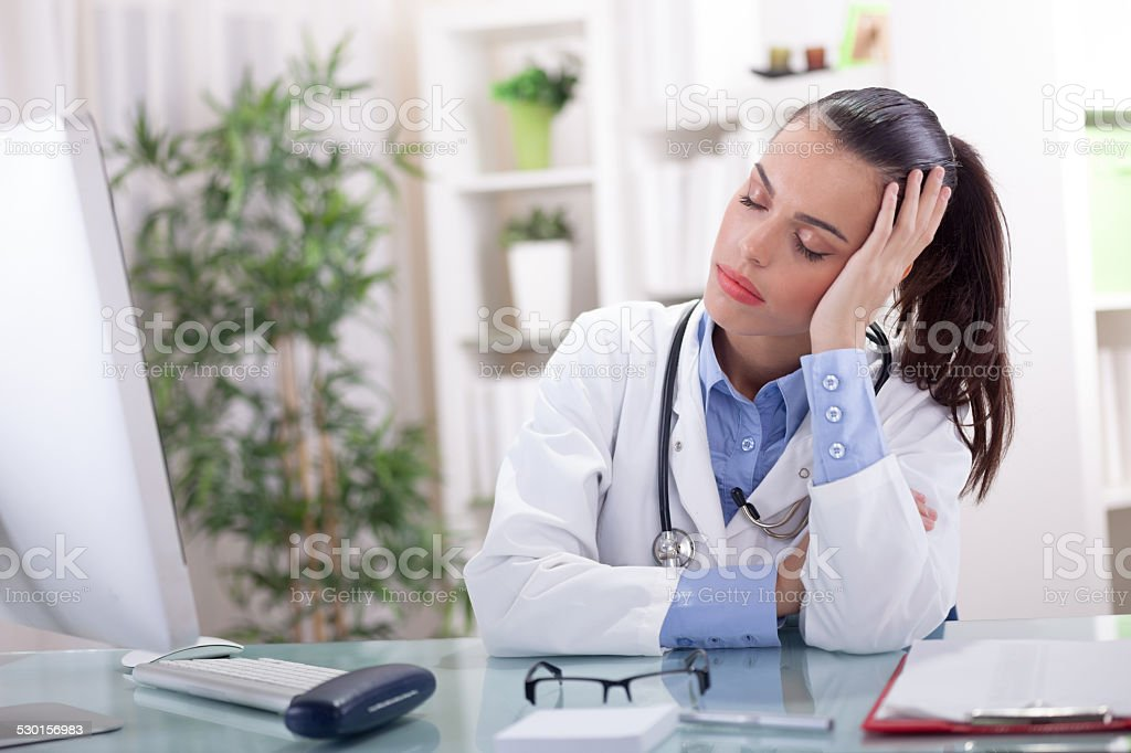 young doctor sleeping in the office, too much work stock photo