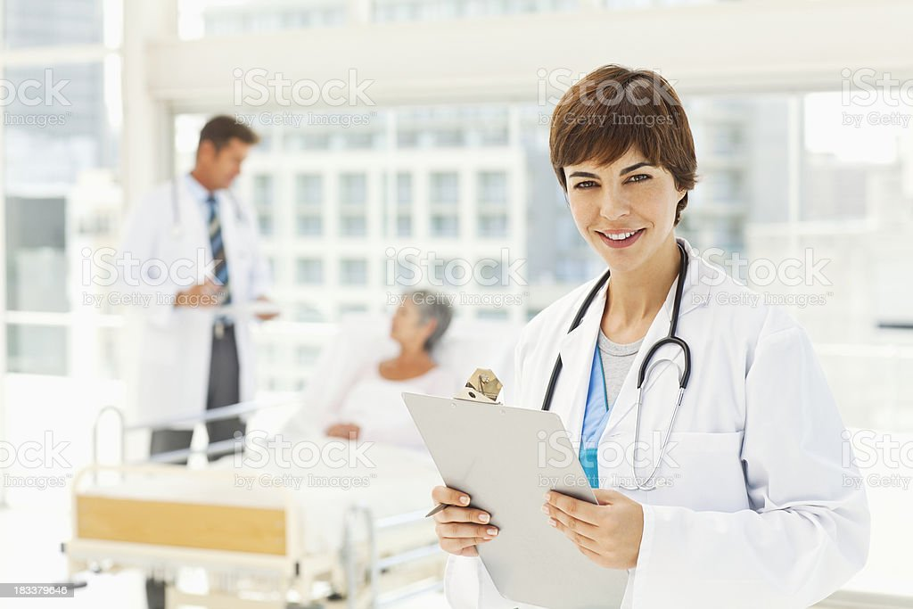 Young Doctor Smiling in a Hospital Room royalty-free stock photo
