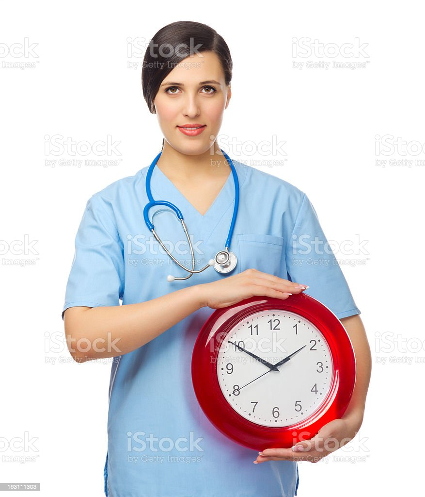 Young doctor with clock royalty-free stock photo