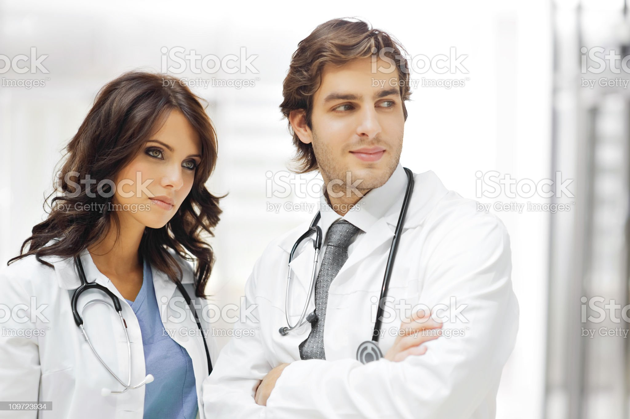 Young doctor with colleague in the background royalty-free stock photo