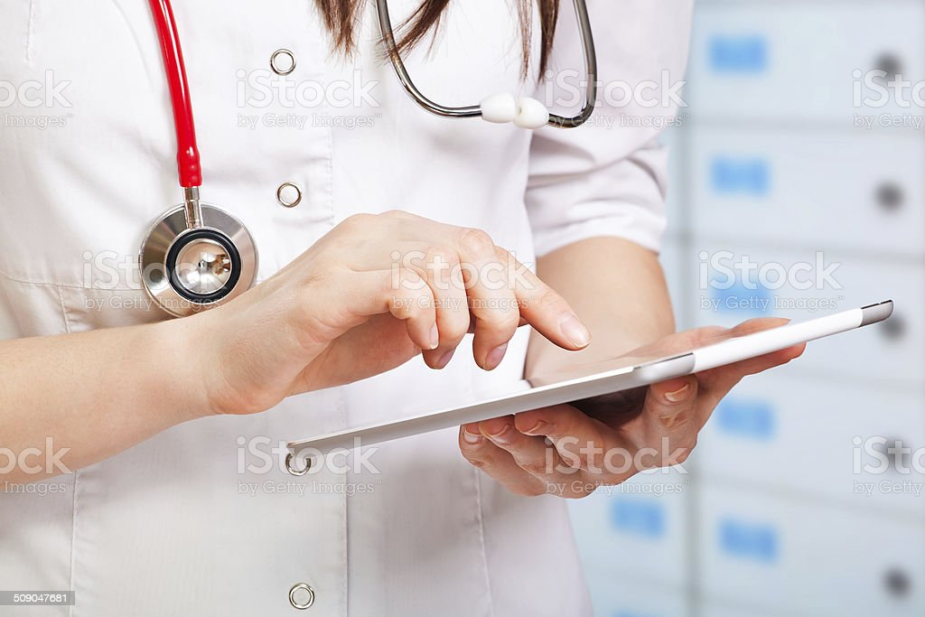 young doctor with digital tablet stock photo