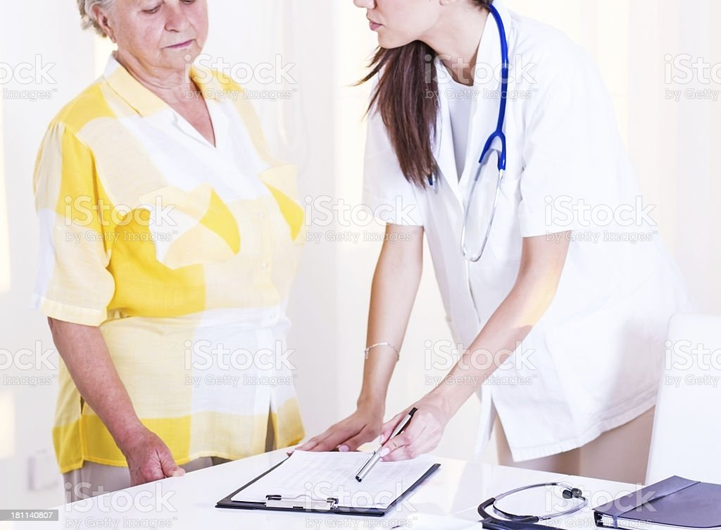 Young doctor with patient. royalty-free stock photo