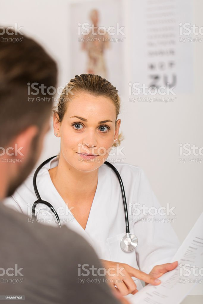 young doctor with patient stock photo