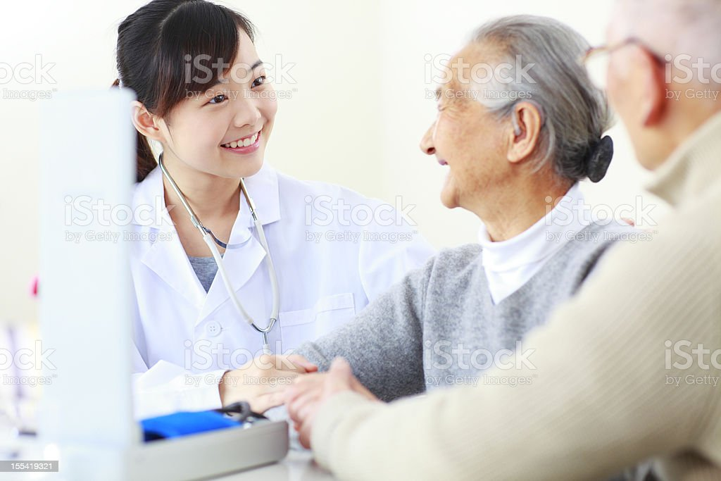 young doctor with senior patient royalty-free stock photo