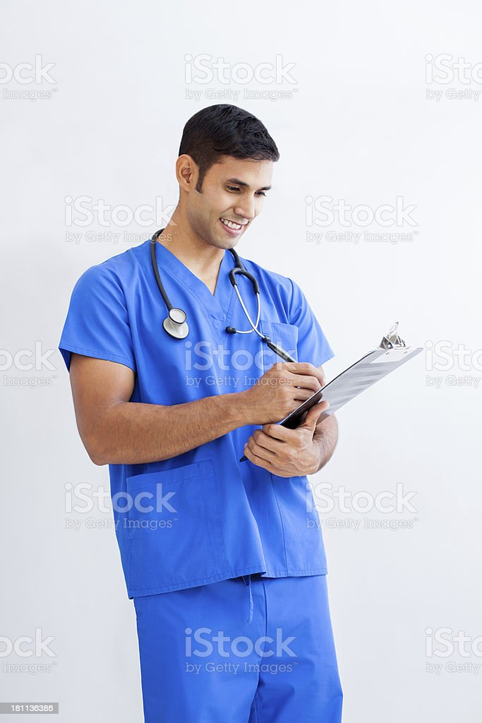 Young doctor writing a prescription royalty-free stock photo
